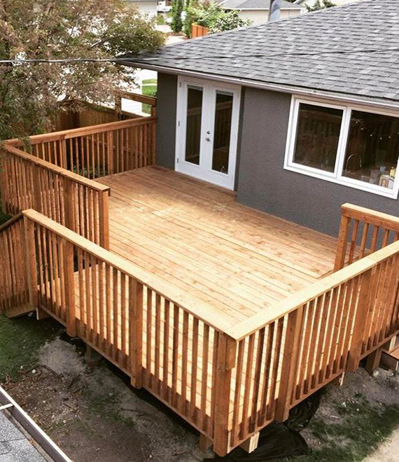 Wooden deck of a grey house- Calgary deck builders